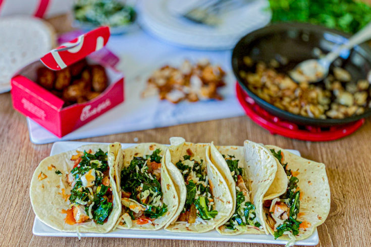 Chick Fil A Tacos with nuggets and onion in background