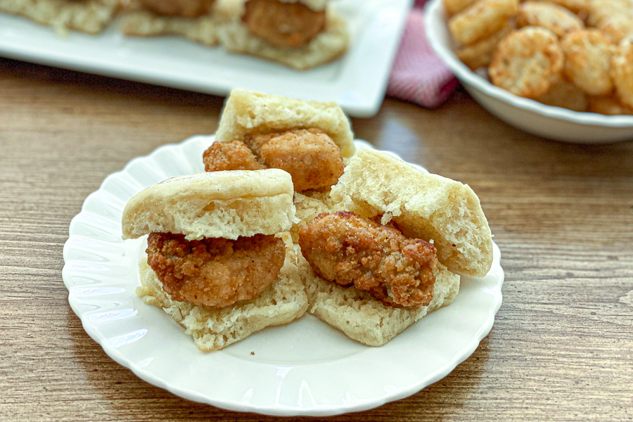 Mini Chicken Biscuits on a plate with hashbrowns in the background