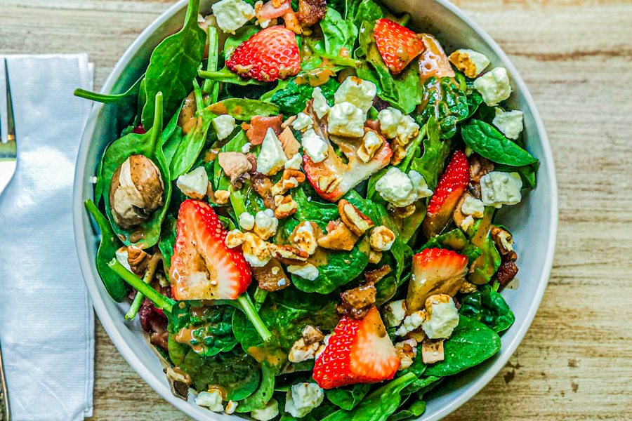 a close up picture of our Spinach Walnut Feta Salad
