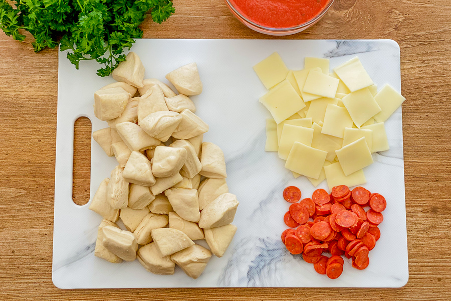 Ingredients for Air Fryer Pizza Rolls on a cutting board