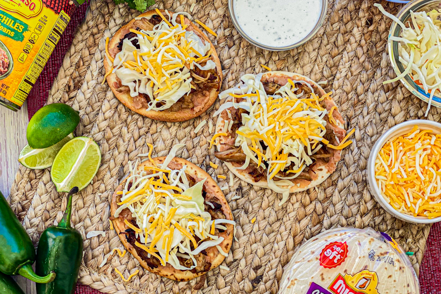 Tostada shells topped with pork and cheese.
