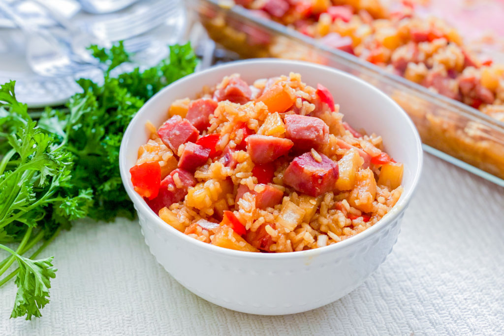 A white bowl full of our Easiest Ham and Rice Casserole.