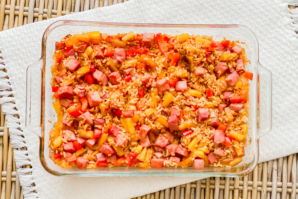 Our Easiest Ham and Rice Casserole in a clear casserole dish about to be placed in the oven.