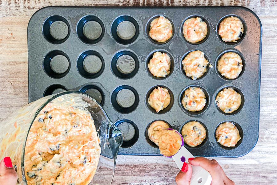 Pouring morning muffin mixture into muffin pan