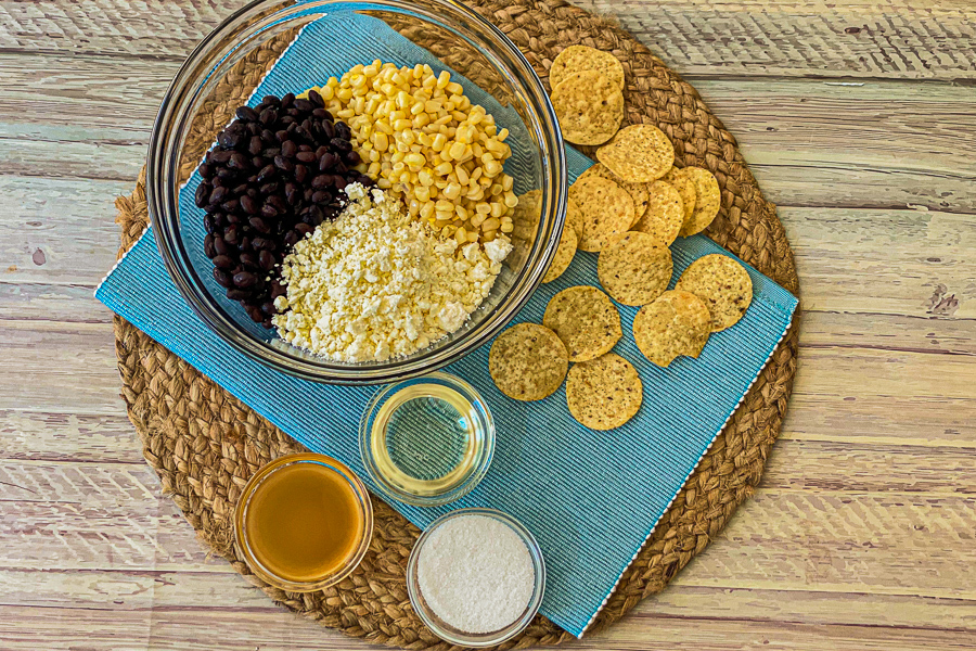 Individual ingredients on a placemat with tortilla chips