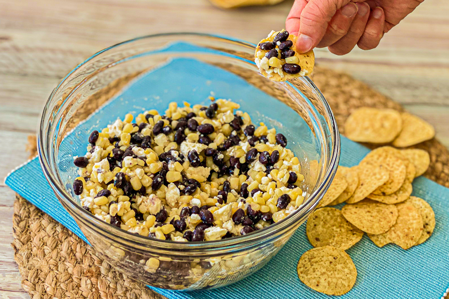 Black Bean Corn and Feta Dip in a bowl with tortilla chips