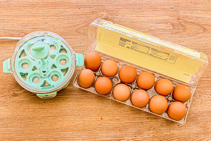 A dozen eggs and egg cooker