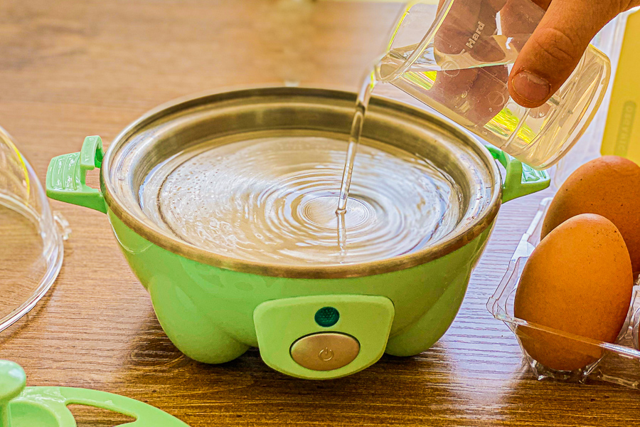 Pouring water into Rapid Egg Cooker