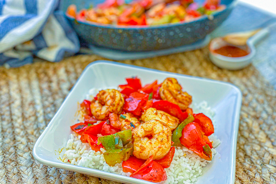 Our Healthy Blackened Shrimp Skillet on a bed of rice in a white bowl.