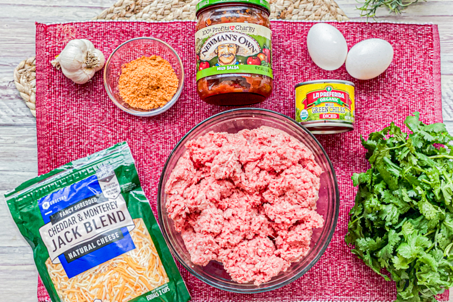 The ingredients for the Mexican Meatloaf with Salsa on a red placemat.