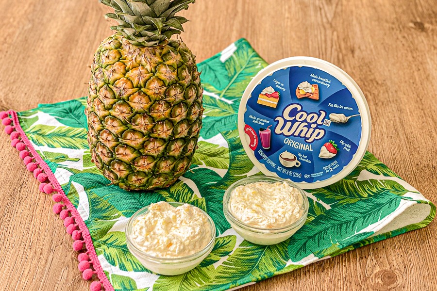 Pineapple Cool Whip Dessert on a palm tree towel with pineapple and cool whip