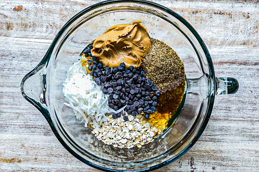 Ingredients for Almond Butter Protein Bites in a glass bowl