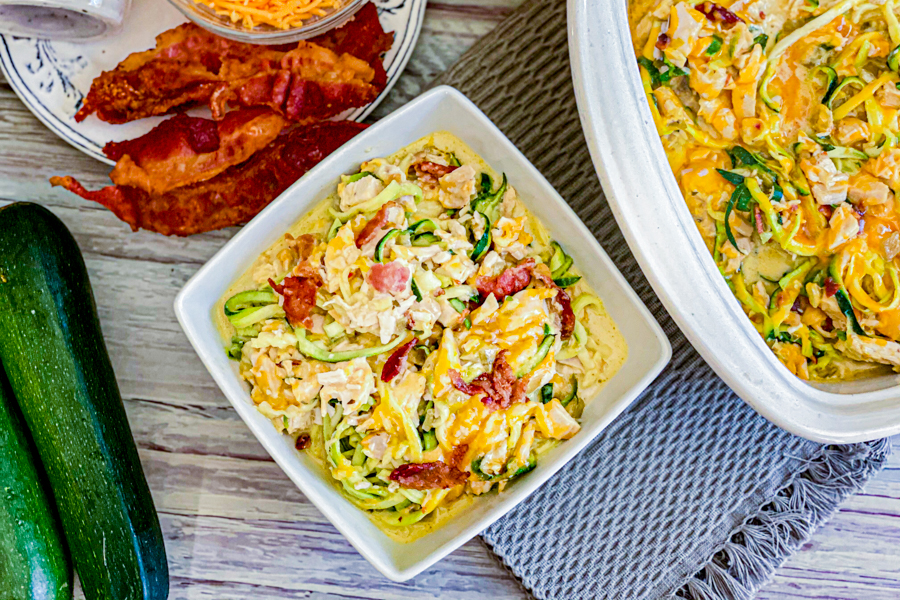 The Cheesy Zucchini Chicken Casserole in a white bowl after being cooked, ready to serve!