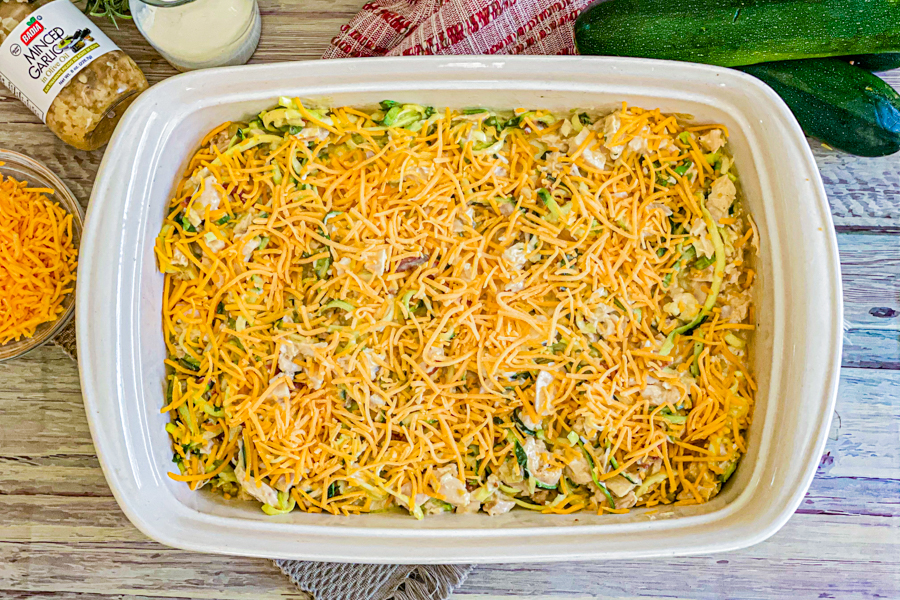 The Cheesy Zucchini Chicken Casserole in a dish about to be cooked.