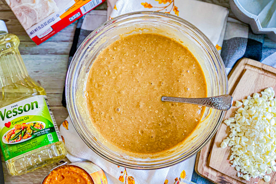 All ingredients mixed into a batter, in a glass bowl, before being poured into a bundt pan.