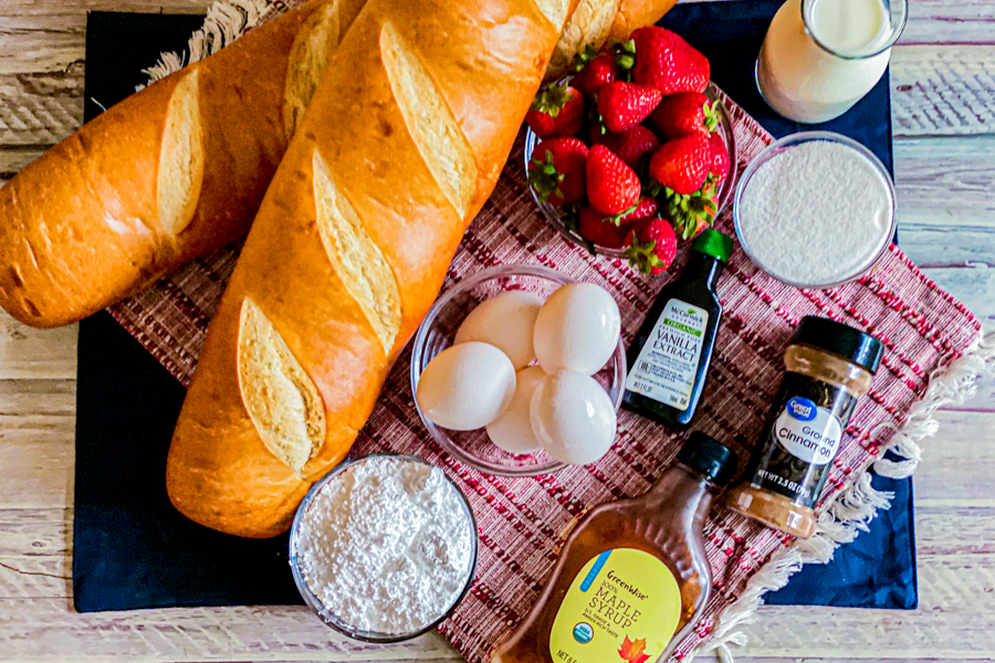 The ingredients for The Perfect French Toast Recipe all laid flat on a placemat.