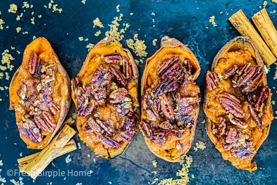 The Roasted Pecan Sweet Potato Boats on a black baking sheet ready to be served.