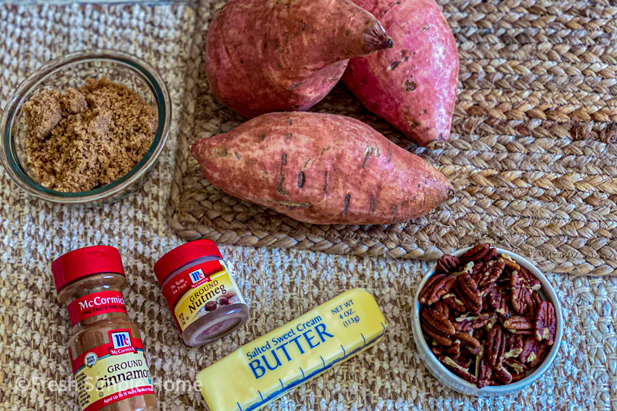 Ingredients for the Roasted Pecan Sweet Potato Boats laid out flat on a table.