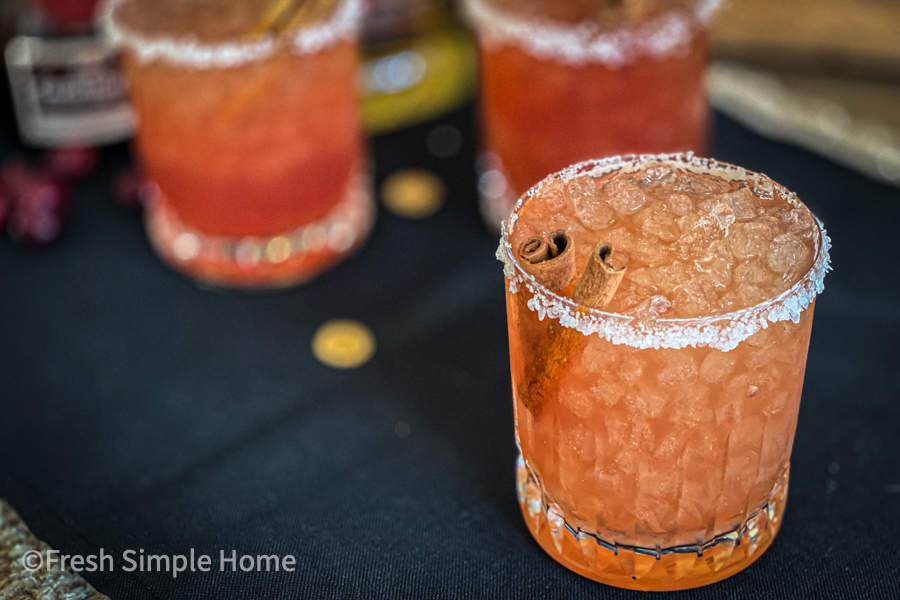 The Perfect Fall Margarita, garnished with a cinnamon stick, ready to be served.