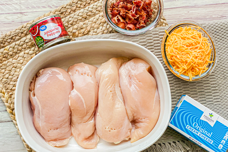 The ingredients for the Jalapeño Chicken Popper Bake laid flat on a brown placemat.