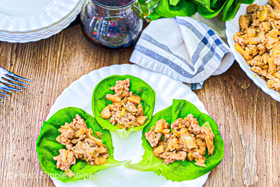 Simple Chicken Lettuce Wraps on a white plate, ready to be served.
