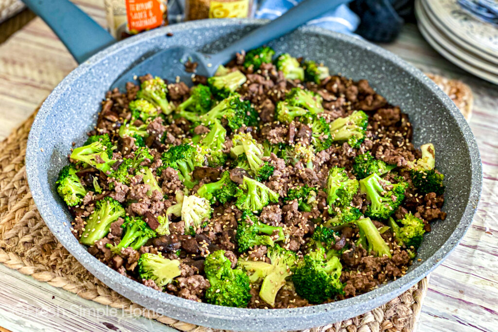 The Teriyaki Beef and Broccoli in a skillet, garnished with sesame seeds, ready to be served.