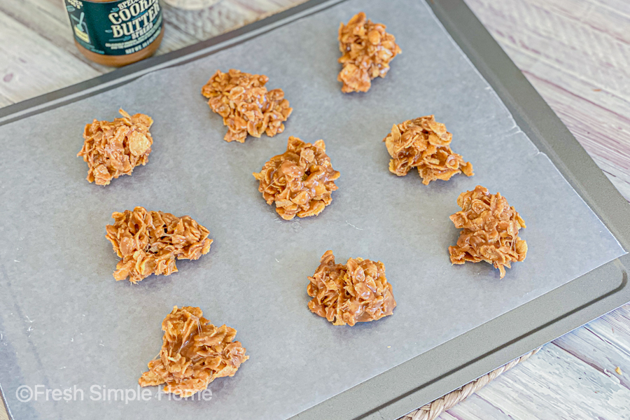 The cookie mixture, formed into circles, cooling on a sheet of wax paper, on a baking sheet.