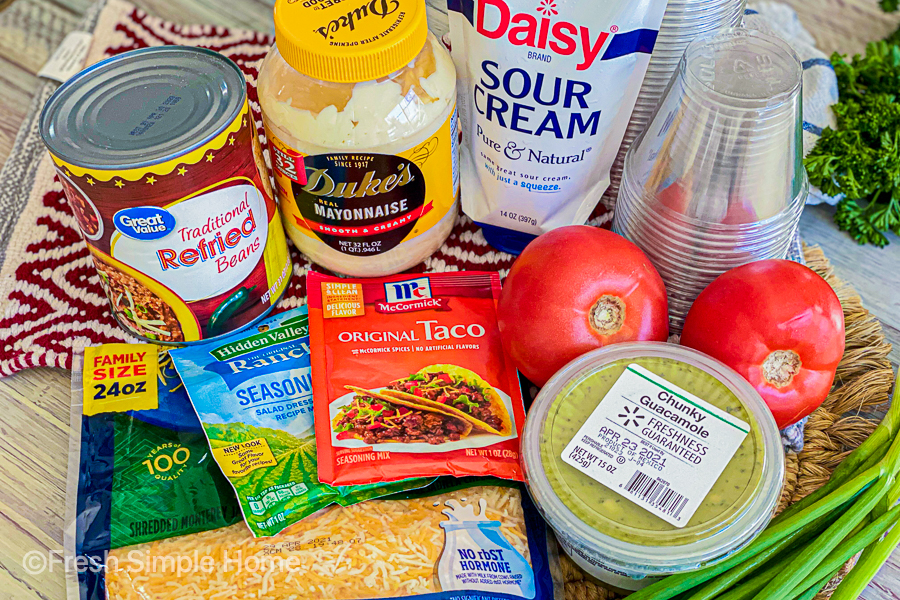 The ingredients laid out for our mini 7 layer dip cups.