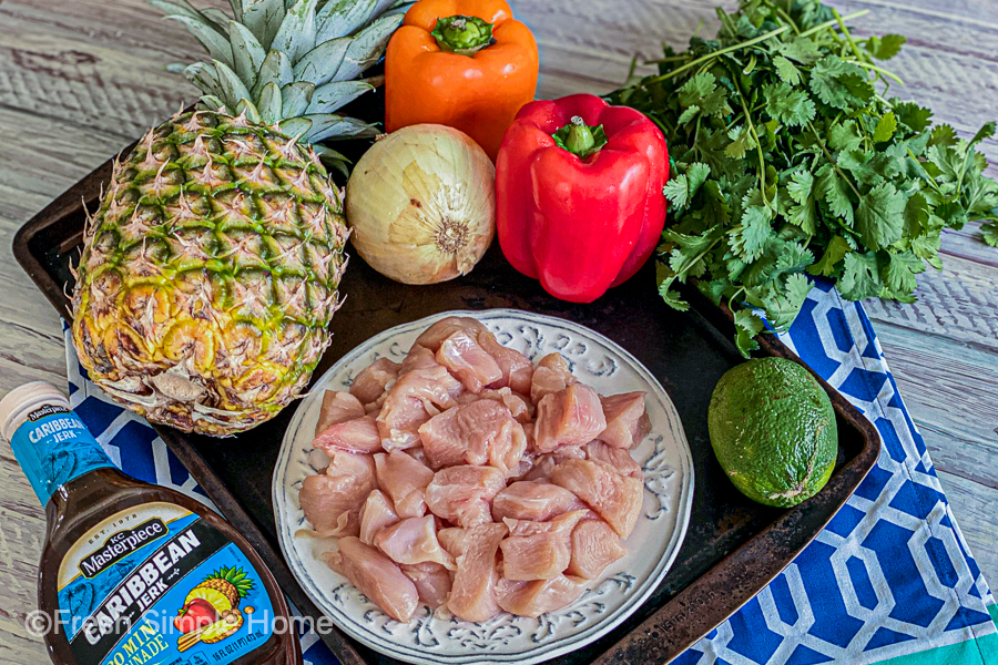 The ingredients for the Sheet Pan Pineapple Jerk Chicken laid out all on a plate.