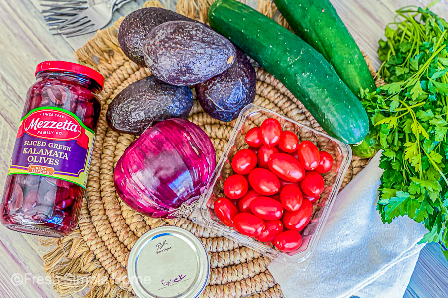 The ingredients for the Vegan 7 Ingredient Greek Salad laid out on a table.