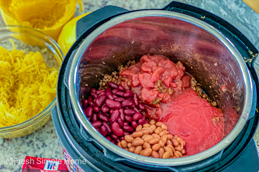 The Instant Pot with all the ingredients before being mixed.