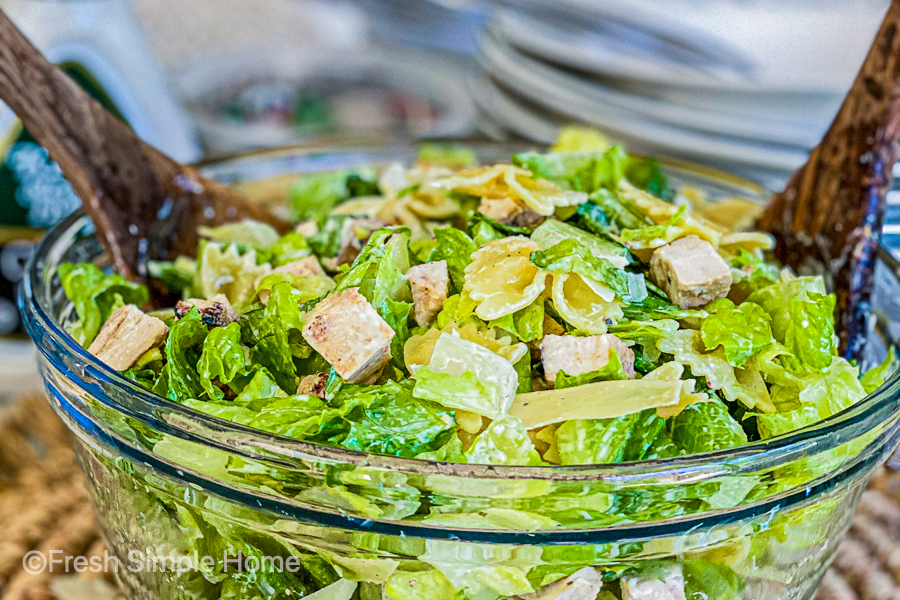 The Zesty Chicken Caesar Pasta Salad in a close up shot right before being served.